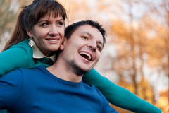 Flying couple in autumn Park Royalty Free Stock Photography