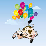 Flying cow. Flying cartoon cow on colorful balloons Stock Photography