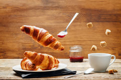 Flying croissant with coffee and jam Stock Photo