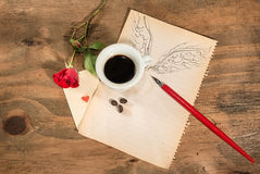Flying cup of coffee with red rose and playing card. Stock Images
