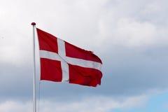 Flying danish flag. Danebrog - flying danish flag on Årø island, denmark Stock Photo