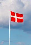 Flying danish flag. Danebrog - flying danish flag with cloudy sky Royalty Free Stock Photos