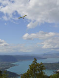 Flying delta wing above lake. Flying delta wing in blue sky above lake Royalty Free Stock Photos