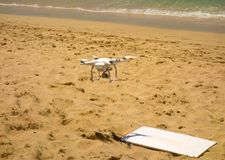 A drone being launched at lower bay beach in the windward islands Royalty Free Stock Images