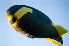 Flying dirigible Stock Image