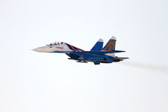 Flying display and aerobatic show of Russian Knights in Bahrain International Airshow Stock Photos