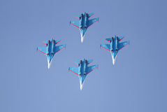 Flying display and aerobatic show of Russian Knights Display Team Stock Photos