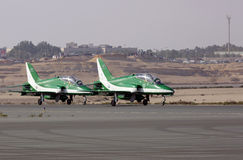 Flying display and aerobatic show of Saudi Hawks display team Stock Photo