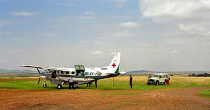 Flying doctors in Africa. Plain from Amref (African Medical Research foundation Royalty Free Stock Images