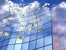 Flying dollars. Falling dollars and corporate building, conceptual image Royalty Free Stock Photo