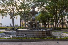 ANTIGUA, GUATEMALA - NOVEMBER 11, 2017: Flying Dove and Fountain in Central Park in Antigua, Guatemala. Antigua is a small city su. Flying Dove and Fountain in Stock Photography