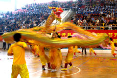 Flying dragon. Dragon is a traditional Chinese folk sports, more than ten individual props up a long dragon, row on dance, dragon flying leap, very grand. Rotate Royalty Free Stock Photos
