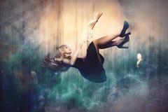 Flying in dreams in space. A girl flies in her dreams, in her fantasies or in space royalty free stock images