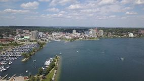 Aerial view of the city and lake 4k. Flying with drone above downtown of Barrie and Lake Simcoe stock video