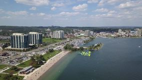 Aerial view of the city and lake 4k. Flying with drone above downtown of Barrie and Lake Simcoe stock video footage
