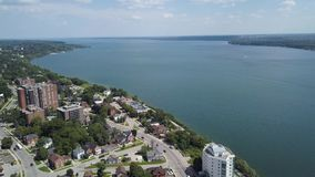 Aerial view of the city and lake 4k. Flying with drone above downtown of Barrie and Lake Simcoe stock footage