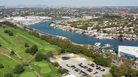 Aerial view of golf course, marina, city and ocean 4k. Flying with drone above golf course and marina in New York stock footage