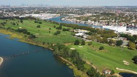 Aerial view of golf course, marina, city and ocean 4k. Flying with drone above golf course and marina in New York stock video footage