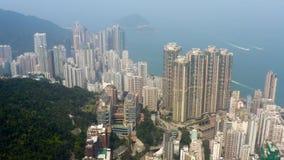 Hong Kong, aerial footage from Victoria peak. Flying with drone above Hong Kong from Victoria peak stock footage