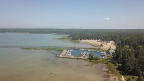 Sauble beach provincial park. Aerial view of the lake Huron. Flying with drone above the Huron lake along the beach stock video footage