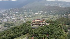 Nepal, Kathmandu. Kopan monastery. Aerial footage. Flying with drone above Kopan monastery in Kathmandu Nepal stock video footage