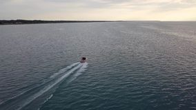 Aerial view of moving boat on the lake. 4k. Flying with drone above moving boat. Lake view stock footage