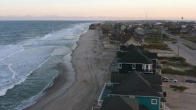 Aerial view of ocean and beach in Rodanthe. 4k. Flying with drone along coast near Rodanthe, NC, USA. Aerial footage of ocean, beach and city stock video footage