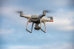 The flying drone. Drone flying in the blue sky take some photo Stock Photo