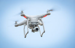 Flying drone with camera. Against blue sky stock photography