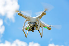 Flying drone with camera Stock Images