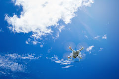 flying drone with camera on the blue sky stock photos
