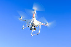 Flying drone with camera in blue sky royalty free stock photos