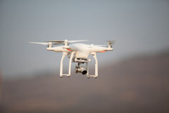 Flying drone with camera on the sky royalty free stock photo