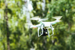 Flying drone with camera on the sky Stock Image