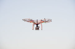 Flying drone with camera on the sky at sunset Royalty Free Stock Photos