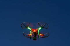 Flying drone with camera on the sky at sunset Stock Photo