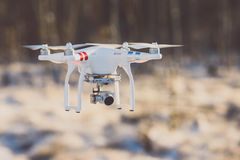 Flying drone with camera, winter scene royalty free stock photo
