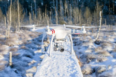 Flying drone with camera, winter scene Stock Photo