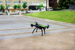 Flying drone in city stock photography