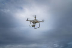 Flying drone with cloudy sky background Stock Images