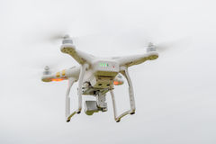 Flying drone on empty sky from back Stock Photography