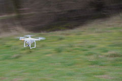 Flying drone in fast motion Stock Photo