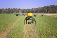 Drone. Flying drone in a field stock images