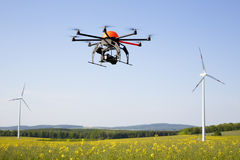 Flying drone in field royalty free stock image