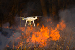 Flying drone in a fire royalty free stock images