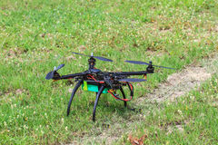 Flying drone on the ground Royalty Free Stock Photo