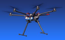 Flying drone isolated on blue. A flying hexacopter without a camera. Includes a clipping path Stock Images