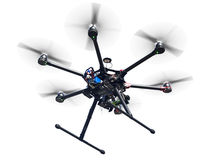 Flying drone isolated on white. A flying hexacopter with spinning propellers without a camera shot from below isolated on white with clipping path Royalty Free Stock Photography