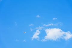 Flying drone leaving high on blue sky with clouds, texture. For modern background, pattern, wallpaper or banner design Royalty Free Stock Photos