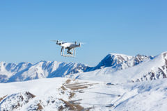 Flying drone in mountain stock photo